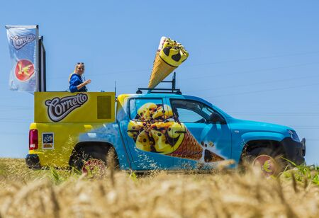 Saint-Quentin-Fallavier, France - July 16, 2016: Cornetto vehicle during the passing of Publicity Caravan in a wheat in the stage 14 of Tour de France 2016.