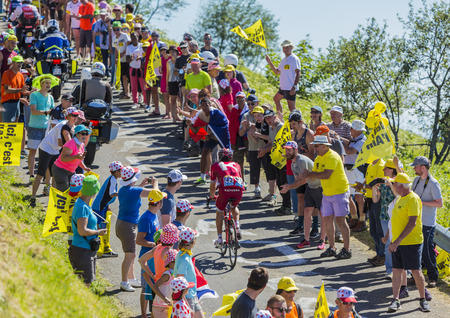 Col du Grand Colombier,France - July 17, 2016: The Spanish cyclist Alberto Losada of Katusha Team riding on the road to Col du Grand Colombier in Jura Mountains during the stage 15 of Tour de France 2016.