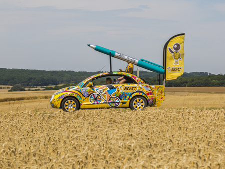 writ: Vendeuvre-sur-Barse, France - 6 July, 2017: The fancy car of BIC passes through a region of wheat fields in the Publicity Caravan before the cyclists during the stage 6 of Tour de France 2017. BIC is a global company which offers an extensive line of writ Editorial