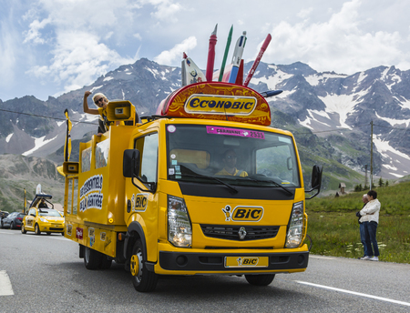 Col du Lautaret, France - July 19, 2014: BIC truck during the passing of the advertising caravan on mountain pass Lautaret during the stage 14 of Le Tour de France 2014. Before the appearance of the cyclists there is a caravan of advertising cars of the a