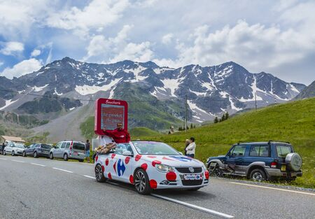 carrefour: Col du Lautaret, France - July 19, 2014: The Carrefour during the passing of the advertising caravan on mountain pass Lautaret during the stage 14 of the Tour de France 2014. Before the appearance of the cyclists there is a caravan of advertising cars Of