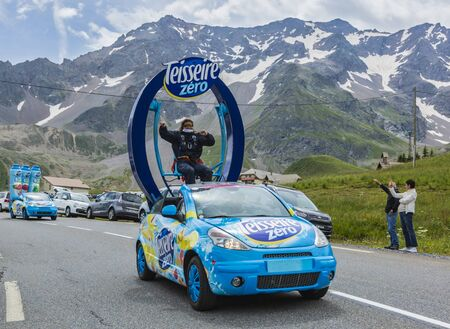 Col du Lautaret, France - July 19, 2014: The vehicle of Teisseire during the passing of the advertising caravan on mountain pass Lautaret during the stage 14 of Le Tour de France 2014. Before the appearance of the cyclists there is a caravan of advertisin