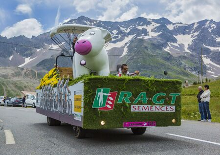 le: Col du Lautaret, France - July 19, 2014: The vehicle of RAGT Semences during the passing of the advertising caravan on mountain pass Lautaret during the stage 14 of Le Tour de France 2014. Before the appearance of the cyclists there is a caravan of advert