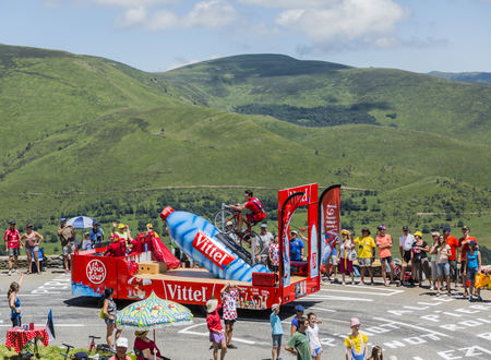 Col de Peyresourde,France- July 23, 2014: Vittel vehicle during the passing of the Publicity Caravan on the road to Col de Peyresourde in Pyrenees Mountains in the stage 17 of  Le Tour de France on 23 July 2014.Vittel is a French bottled water brand.