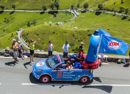 Col de Peyresourde,France- July 23, 2014: X-tra vehicle during the passing of the Publicity Caravan on the road to Col de Peyresourde in Pyrenees Mountains in the stage 17 of  Le Tour de France on 23 July 2014. X-tra is a good detergent for all fabrics pr