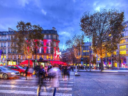 champs elysees: Paris,France - 27 November 2016: Dusk image of blurred pedestrians crossing the street on the famous Champs Elysees Boulevard in Paris festive decorated during the winter holidays.