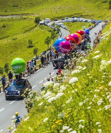 Col de Peyresourde,France- July 23, 2014: Fancy vehicle of Senseo vehicles passing in the Publicity Caravn on the road to Col de Peyresourde in Pyrenees Mountains during the stage 17 of  Le Tour de France 2014.Senseo is a registered trademark for a coffee