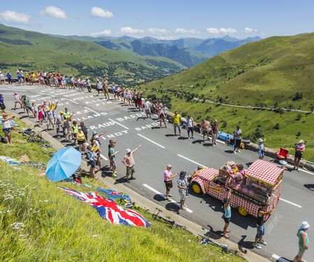 Col de Peyresourde,France- July 23, 2014: Cochonou vehicle passing in the Publicity Caravn on the road to Col de Peyresourde in Pyrenees Mountains during the stage 17 of  Le Tour de France 2014.Cochonou is an important French brand of short dry sausages.