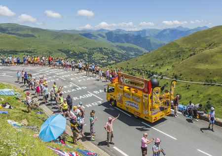 Col de Peyresourde,France- July 23, 2014: BIC vehicle passing in the Publicity Caravn on the road to Col de Peyresourde in Pyrenees Mountains during the stage 17 of  Le Tour de France 2014.BIC is a global company which offers an extensive line of writing