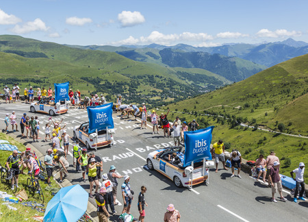 le: Col de Peyresourde,France- July 23, 2014: Ibis Budget vehicle passing in the Publicity Caravn on the road to Col de Peyresourde in Pyrenees Mountains during the stage 17 of  Le Tour de France 2014. Ibis Budget Hotel is an international chain of cheap hote