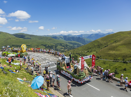 carrefour: Col de Peyresourde,France- July 23, 2014: Carrefour vehicle passing in the Publicity Caravn on the road to Col de Peyresourde in Pyrenees Mountains during the stage 17 of  Le Tour de France 2014.