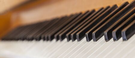 Close-up with very low depth of field and an interesting perspective of a piano keys. Stock Photo