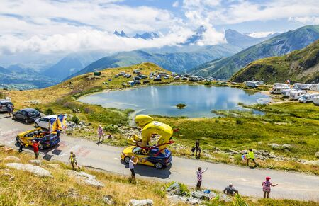 Col de la Croix de Fer, France - 25 July 2015: LCL caravan driving on the road to the Col de la Croix de Fer in Alps during the stage 20 of Le Tour de France 2015. LCL was the largest bank in France and sponsored continuosly the TDF.