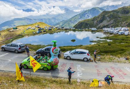 Col de la Croix de Fer, France - 25 July 2015: Teisseire caravan driving on the road to the Col de la Croix de Fer in Alps during the stage 20 of Le Tour de France 2015. Teisseire produces fruit juices and syrups for the food service industry.
