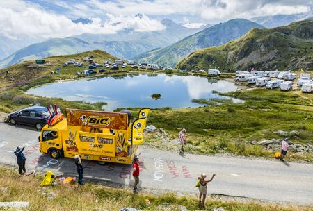 Col de la Croix de Fer, France - 25 July 2015: BIC caravan driving on the road to the Col de la Croix de Fer in Alps during the stage 20 of Le Tour de France 2015. BIC is a global company which offers an extensive line of writing and office tools.