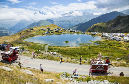 Col de la Croix de Fer, France - 25 July 2015: Banette caravan driving on the road to the Col de la Croix de Fer in Alps during the stage 20 of Le Tour de France 2015. Banette is the leading brand for the artisan bread in France. Editorial