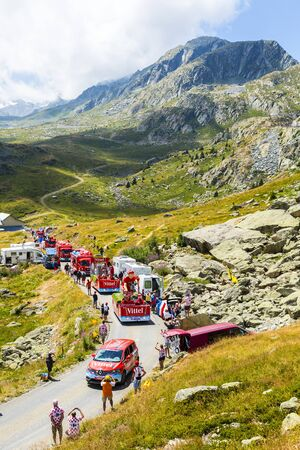 Col de la Croix de Fer, France - 25 July 2015: Vittel caravan driving on the road to the Col de la Croix de Fer in Alps during the stage 20 of Le Tour de France 2015. Vittel is a French bottled water brand.