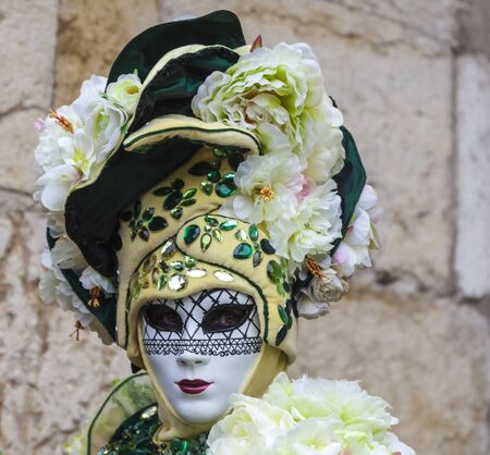 Annecy, France, February 23, 2013: Portrait of a disguised person posing in Annecy, France, during a Venetian Carnival which celebrates the beauty of the real Venice.