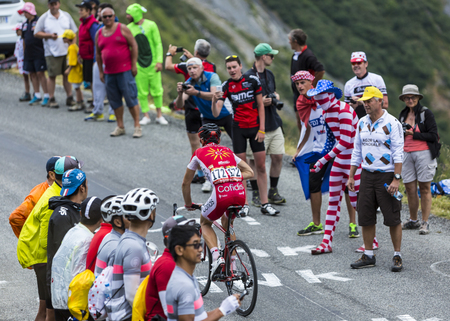 Col du Glandon, France - July 24, 2015: The French cyclist Nicolas Edet of Cofidis Team,climbing the road to Col du Glandon in Alps, during the stage 19 of Le Tour de France 2015.