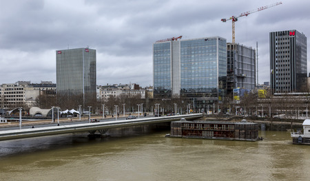 PARIS,FRANCE - January 29, 2018: Cityscape of Paris with the Seine River that rose significantly, increasing the risk of flooding in Paris during the last days of January 2018. Here is the Austerlitz area of the river with modern buildings and Charles de