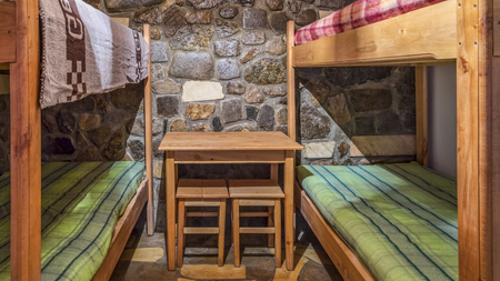 Bedroom with bunk beds in a wooden chalet. Stock Photo
