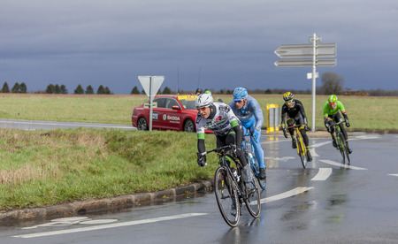Cernay-la-Ville, France - March 5, 2017: The breakaway taking a curve on a wet road during the first stage of Paris-Nice on 5 March, 2017.