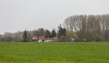 Templeuve, France - April 08, 2018: The Lithuanian cyclist Evaldas Siskevicius of Delko-Marseille Provence KTM Team riding alone in Templeuve during Paris-Roubaix 2018. Editorial