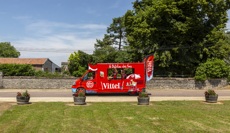 Magny-Fouchard, France - 6 July, 2017: Vittel truck passes through a French village in the Publicity Caravan before the cyclists during the stage 6 of Tour de France 2017. Vittel is a French bottled water brand.