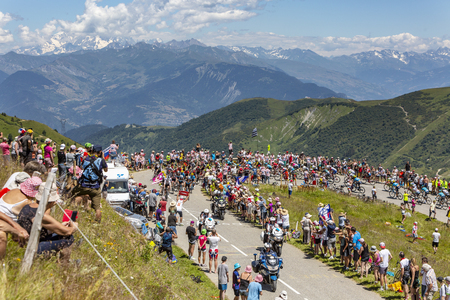 Col de la Madeleine, France - July 19, 2018: Beautiful landscape image with Mont Blanc covered by clouds in the background and the peloton climbing the road to Col de la Madeleine, during the stage 12 of Le Tour de France 2018 Editorial