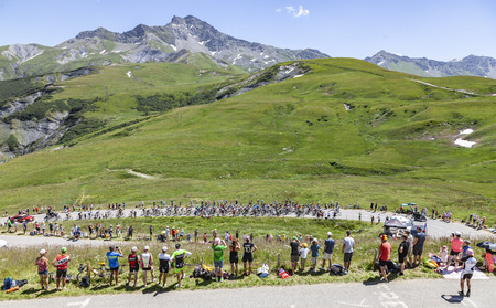 Col de la Madeleine, France - July 19, 2018: The peloton climbing the road to Col de la Madeleine in the French Alps, during the stage 12 of Le Tour de France 2018