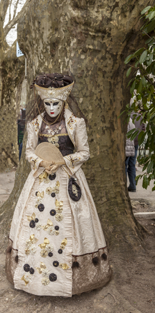 Annecy, France, March 15, 2014:  Portrait of a disguised person, posing in Annecy, France, during a Venetian Carnival which celebrates the beauty of the real Venice. Editöryel