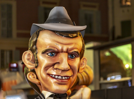 Nice, France - 16.02.2019: Image of a mascot of the President Macron appearing in the night parade- King of Cinema- during Nice Carnival 2019. The theme of this years carnival is the cinema, because the studios of Victoire celebrate their 100 years. Editorial