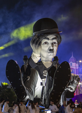 Nice, France - 16.02.2019: Image of the carnival float of Charlie Chaplin appearing in the night parade- King of Cinema- of the Carnaval de NIce 2019.The theme of this year's carnival is the cinema, because the studios of Victoire celebrate their 100 year Banque d'images - 120229661