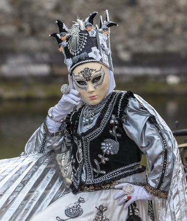 Annecy, France, March 15, 2014:  Portrait of a disguised person, posing in Annecy, France, during a Venetian Carnival which celebrates the beauty of the real Venice. Editorial