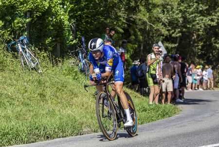 Bosdarros, France - July 19, 2019: The Spanish cyclist Enric Mas of Team Deceuninck-Quick Step riding during stage 13, individual time trial, of Le Tour de France 2019. Editorial