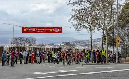 Barcelona, Spain - March27, 2016: The peloton riding during Volta Ciclista a Catalunya, on the top of Montjuic in Bracelona Spain, on March 27, 2016. 報道画像