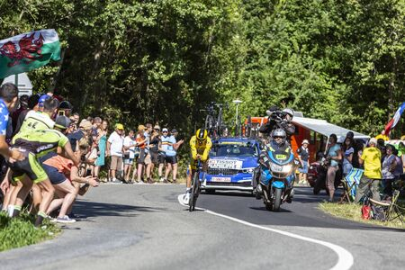Bosdarros, France - July 19, 2019: The French cyclist Julian Alaphilippe of Team Deceuninck-Quick Step in Yellow Jersey riding during stage 13, individual time trial, of Le Tour de France 2019.