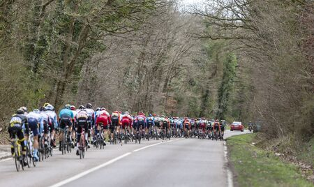 Les Granges-le-Roi, France - March 11, 2019: The peloton riding on Cote des Granges-le-Roi during the stage 2 of Paris-Nice 2019. Publikacyjne