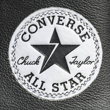 Chartres, France - Spetember 2, 2019: Close-up of the logo of All Star Converse sneakers seen on a leather surface 報道画像