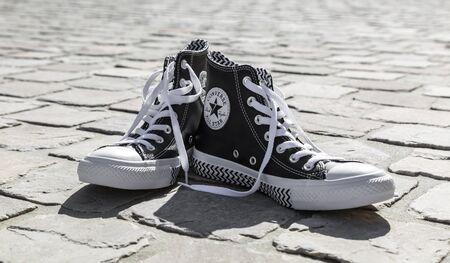 Chartres, France - Spetember 2, 2019: Image of a pair of All Star Converse sneakers on a cobblestone street. 報道画像