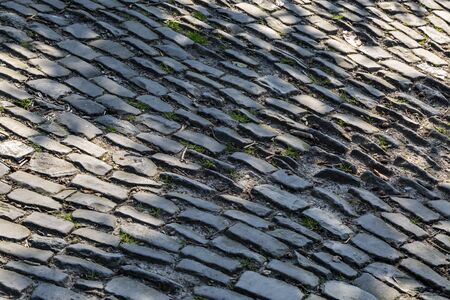 Detail of the famous cobblestone road Muur van Geraardsbergen located in Belgium. On this road every year is organized the famous one day road cycling race Tour of Flanders. Stockfoto
