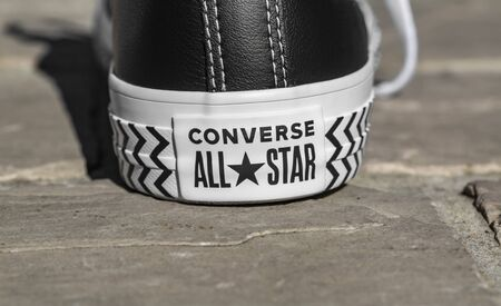 Chartres, France - Spetember 2, 2019: Image of the lower part of the back of an All Star Converse sneaker in a cobblestone street.