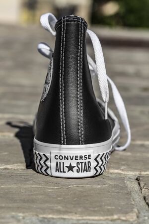 Chartres, France - Spetember 2, 2019: Image of the back of an All Star Converse sneaker in a cobblestone street.