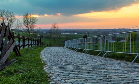 Sunset over the famous road climbing the Paterberg hill in Eastern Flanders. The road is often part of the route of Tour of Flanders. Stockfoto