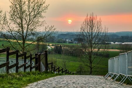 Sunset over the famous road climbing the Paterberg hill in Eastern Flanders. The road is often part of the route of Tour of Flanders.