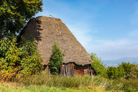 """Landscape in an isolated mountainous rural area in Apuseni Mountains in Transylvania Romania. The place is known as """"Motilor country"""". The house is made exclusively by wood with any pieces of iron. Stock fotó"""