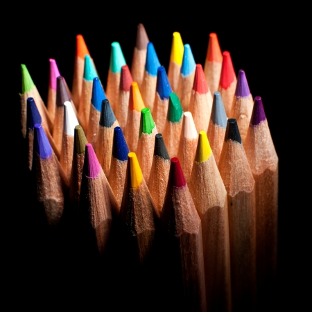 Top view of colored pencils, isolated on a black background Stok Fotoğraf