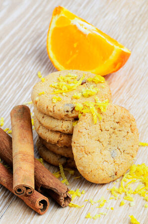 cookies and orange fruit on wood background Stok Fotoğraf