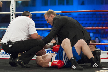 GALATI, ROMANIA - AUGUST 23: Ionut Trandafir got knocked out by Flavius Biea fight at the WBO welterweight title,  on August 23, 2013, in Galati, Romania.