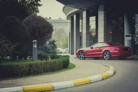 benz: BUCHAREST, ROMANIA - JUNE 11:  Mercedes Benz SL 63 AMG in front of a luxury hotel on June 11, 2009 in Bucharest, Romania.